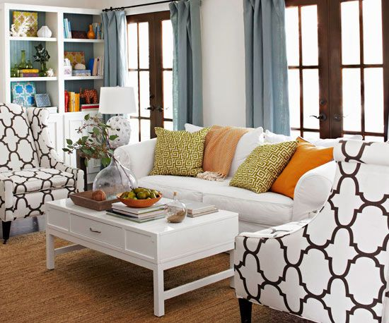 "Combining blue and brown is a go-to color palette. ""The way to update this classic pairing is to bring in bold leaf green, ivory, and citrus orange for your throw pillows. Every room needs a bit of citrus pop."""