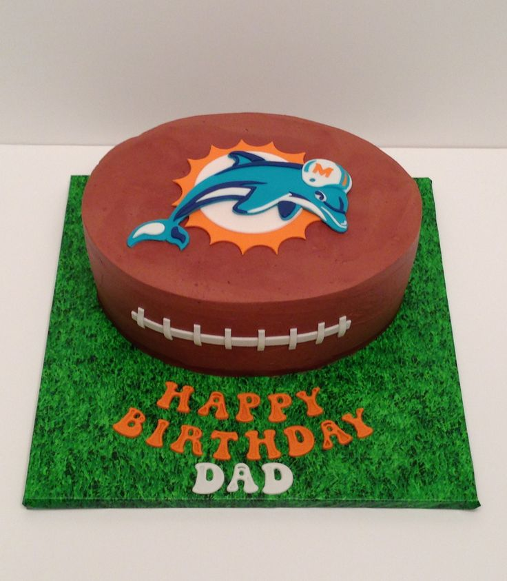 Miami Dolphins football cake. Mocha Swiss meringue buttercream with fondant details.
