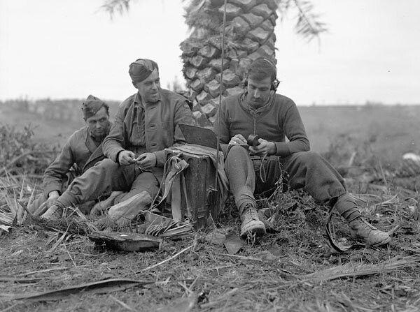 WW2 No 18 British Wireless Radio set.  Infantrymen of The Loyal Edmonton Regiment operating a No. 18 wireless set outside Regimental Headquarters, Ortona, Italy, December 21, 1943