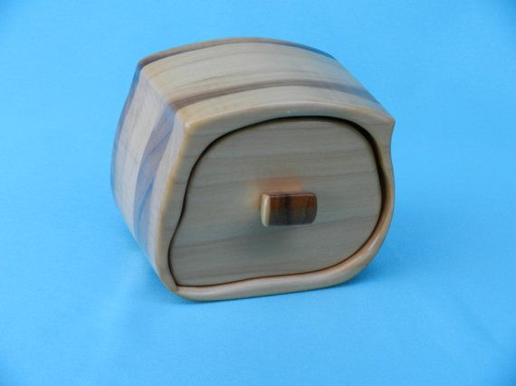 Band saw box is a free form creation that is made up of sheets of poplar glued together in a billet and then cut using a template. The box measures