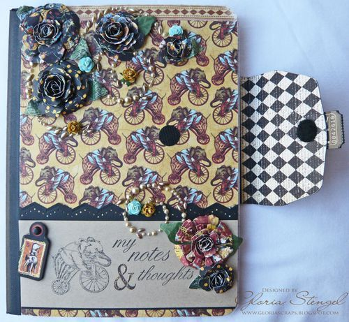 Awesomely beautiful altered composition book!                                                                                                                                                      More