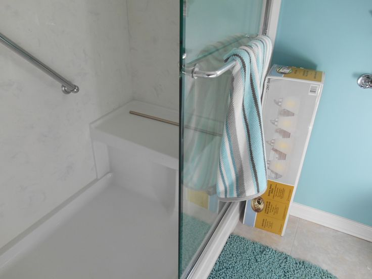 Kohler shower base with seat with cultured marble walls fit to it