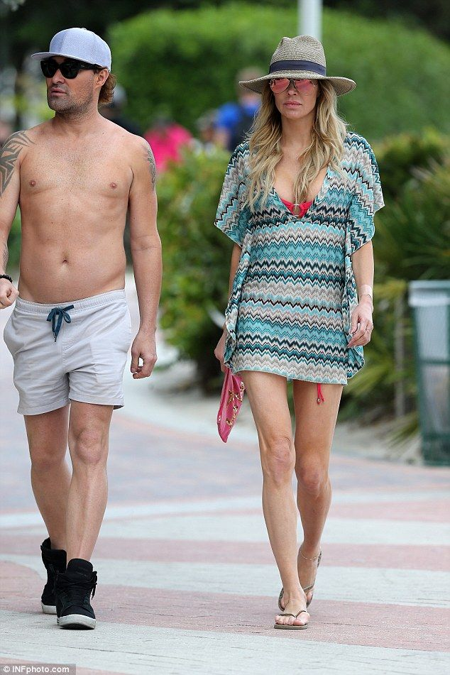 Miami heat! Brandi Glanville covered up her hot pink bikini with a skimpy sun dress on Friday in the Florida beach town