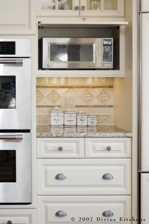 Love the idea of having the microwave in a cupboard! It drives me nuts sitting on the counter.