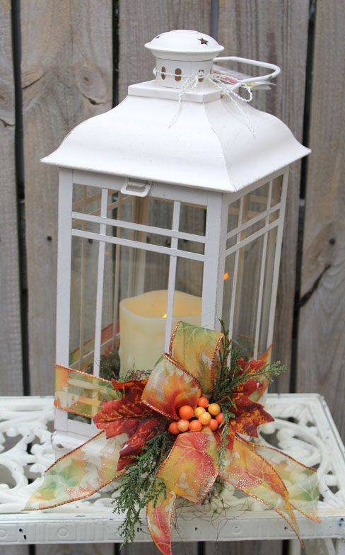 White lantern wiith memory candle and fall decor