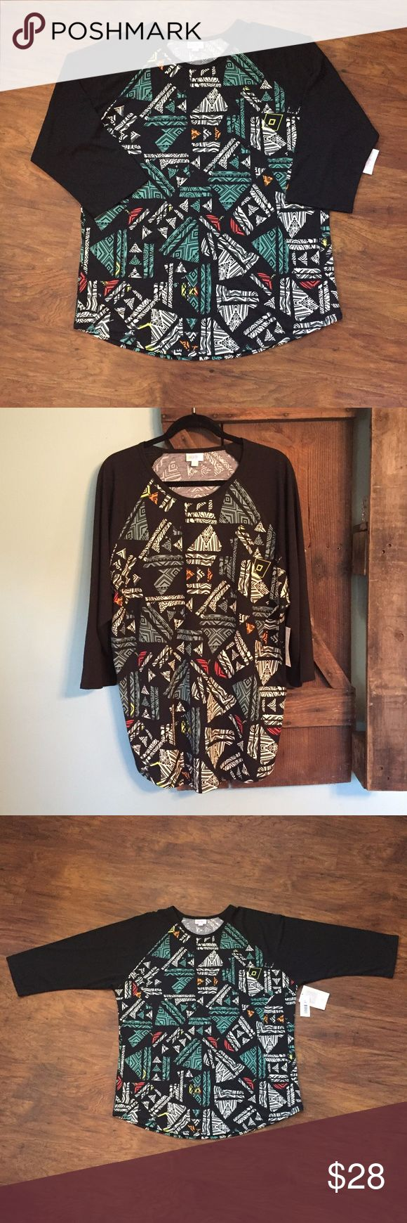 NWT LuLaRoe Randy Size 3XL Black White Aztec Top Aztec print Randy topwith colors of predominantly black, white, and teal, with some red, orange and yellow, black sleeves.  This is new with tags attached. LuLaRoe Tops Tees - Long Sleeve