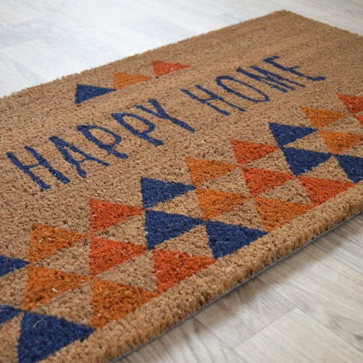 "Paillasson ""Happy Home"", en fibre naturelle de coco. Format rectangulaire 45 x 75 cm. En exclusivité chez decoweb.com"