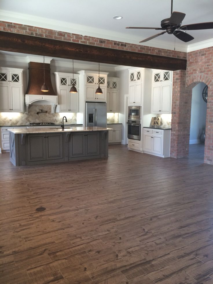 Alabaster antiqued cabinets, dovetail gray island, ceramic floors, faux copper vent hood