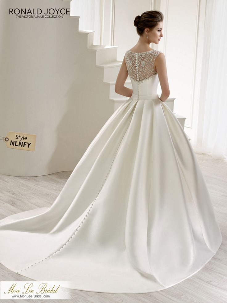 Style NLNFY LENAA MIKADO BALL GOWN WITH A BEADED TULLE ILLUSION NECKLINE/BACK, BUTTON BACK DETAIL AND A BEADED MOTIF ON THE WAISTBAND. PICTURED IN IVORY.COLOURSWHITE, IVORY