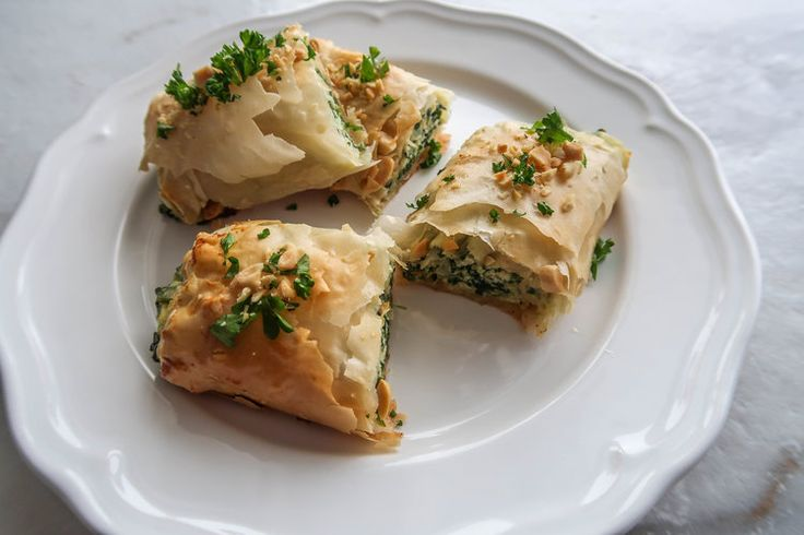 Crunchy, creamy, easy to make. Spanakopita is a Greek spinach-based savoury pastry. This interpretation uses fresh spinach, creamy ricotta, and chopped peanuts with plenty of butter in between each phyllo pastry layer.