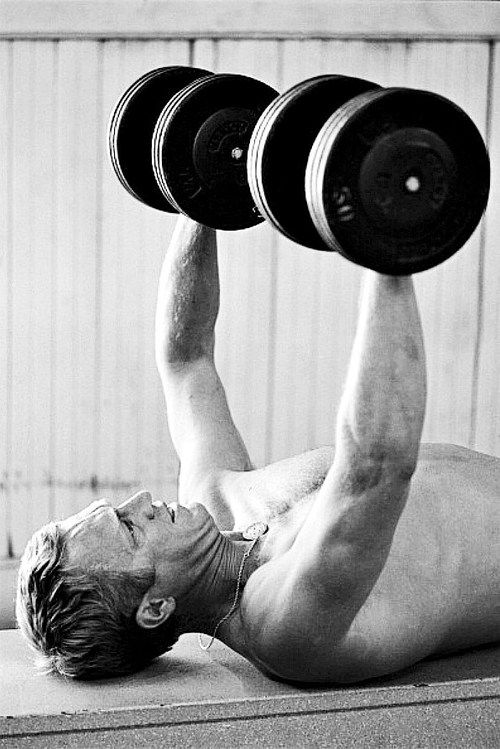 Steve McQueen working out photographed by John Dominis, 1963.