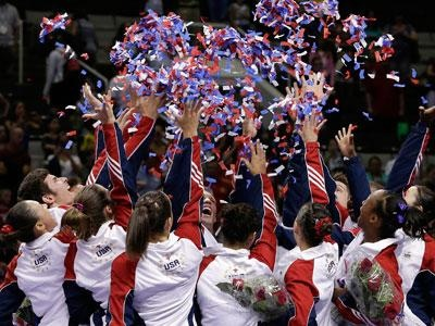 The full 2012 USA Gymnastics Olympic team celebrates at the end of competition at the Olympic Trials.  The team includes: John Orozco, Danell Leyva, Sam Mikulak, Alex Naddour, Steven Legendre, Jake Dalton, Chris Brooks, Jonathan Horton, Gabby Douglas, Aly Raisman, Anna Li, McKayla Maroney, Jordyn Wieber, Kyla Ross, Elizabeth Price and Sarah Finnegan.