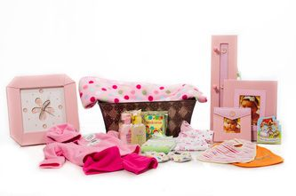 "Girl ""Deluxe Nursery"" Basket - Tin Basket, Matching Pink Large Baby Album, Small Photo Frame, Clothes Hooks, Blanket, Two Bibs, Four Face Cloths, Story Book, One Pair Slippers, One Under-Shirt, One Sleeper Set, Johnson & Johnson Baby Time Bath Set and One Complimentary Welcome Baby Coffee Packet  $130.00 CAD"
