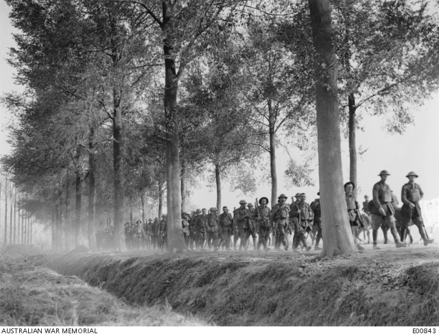 A scene along the Ypres Road, showing a tired Battalion coming out to rest after participating in the fierce fighting during the Third Battle of Ypres.