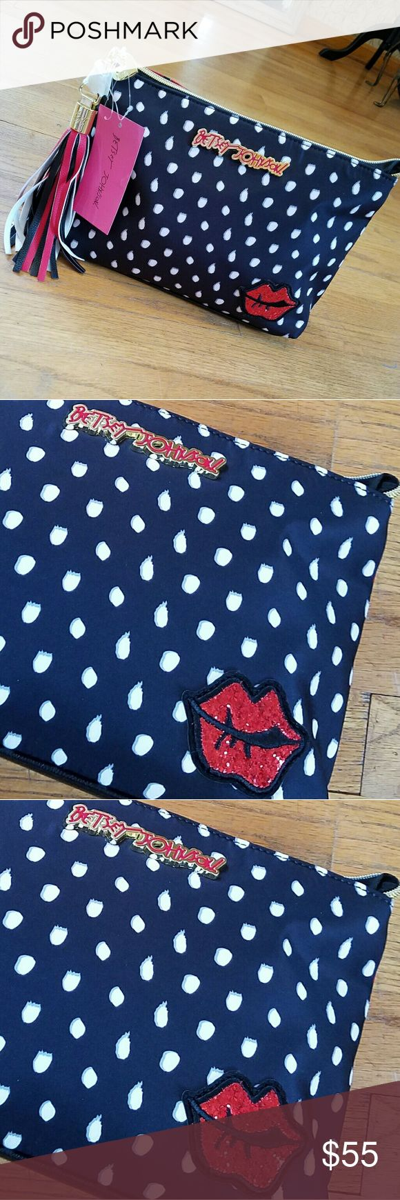 """💋NWT-BETSEY JOHNSON KISS COSMETIC BAG! 💋NWT-BETSEY JOHNSON KISS COSMETIC BAG! SUPER CUTE BAG WITH GREAT LINING INSIDE LOTS OF ROOM INSIDE WITH POCKETS AND ZIPPER. DETACHABLE TASSEL AND A GREAT DESIGN!  SUCH A BEAUTIFUL MAKE UP BAG YOU WILL LOVE IT I ABSOLUTELY LOVE MINE😍😍  SIZE: 9""""L X 12""""W  🌹NWT-BRAND NEW WITH TAGS 🌹100% AUTHENTIC 🌹SAME DAY SHIPPING 🌹OFFERS ACCEPTED THROUGH THE OFFER BUTTON 🌹NO TRADES  🚨CLOSET RULES POSTED PLEASE READ AND FOLLOW NO RUDE COMMENTS! PLEASE BE…"""