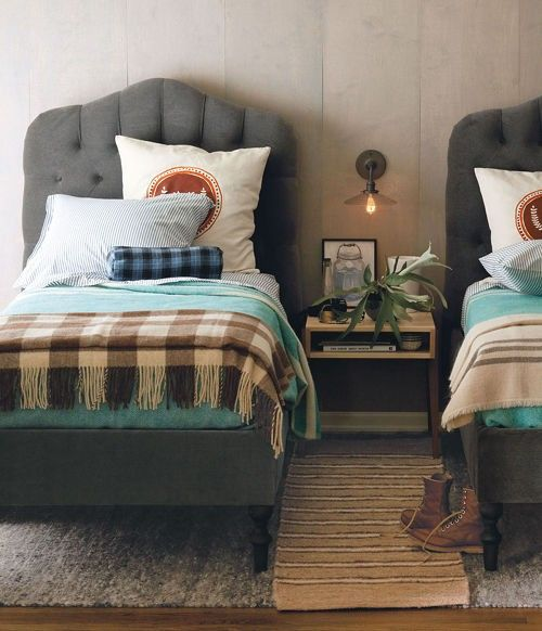 twin beds, tufted gray, plaid blankets, upholstered walls, schoolhouse electric