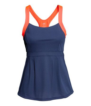 DESCRIPTION Short racerback tennis top in fast-drying, breathable functional fabric. Seam under bust. Lined at top. DETAILS Quick-dry, 100% ...