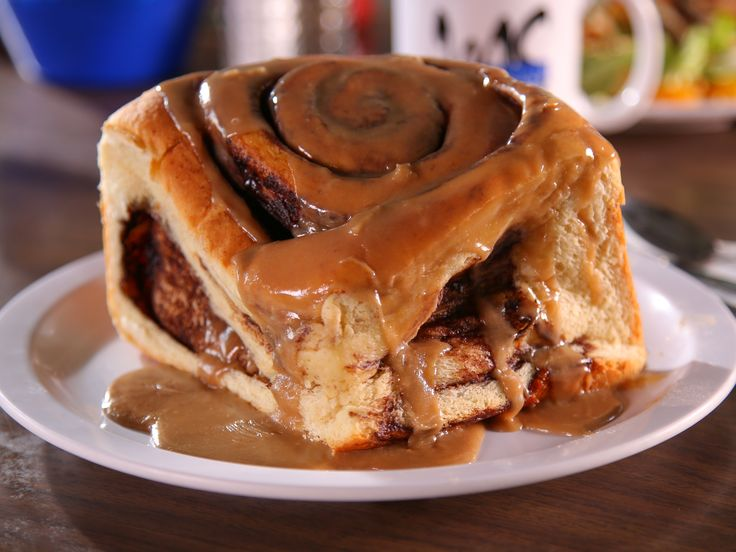 Get this all-star, easy-to-follow Mrs. Manwarren's Cinnamon Rolls recipe from Diners, Drive-Ins and Dives
