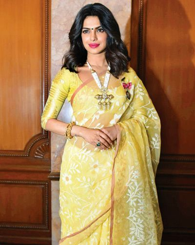 Priyanka Chopra wore a lemon green saree with a statement necklace to accept the Padma Shri award. The outfit did most of the talking for her. She looked beautiful.