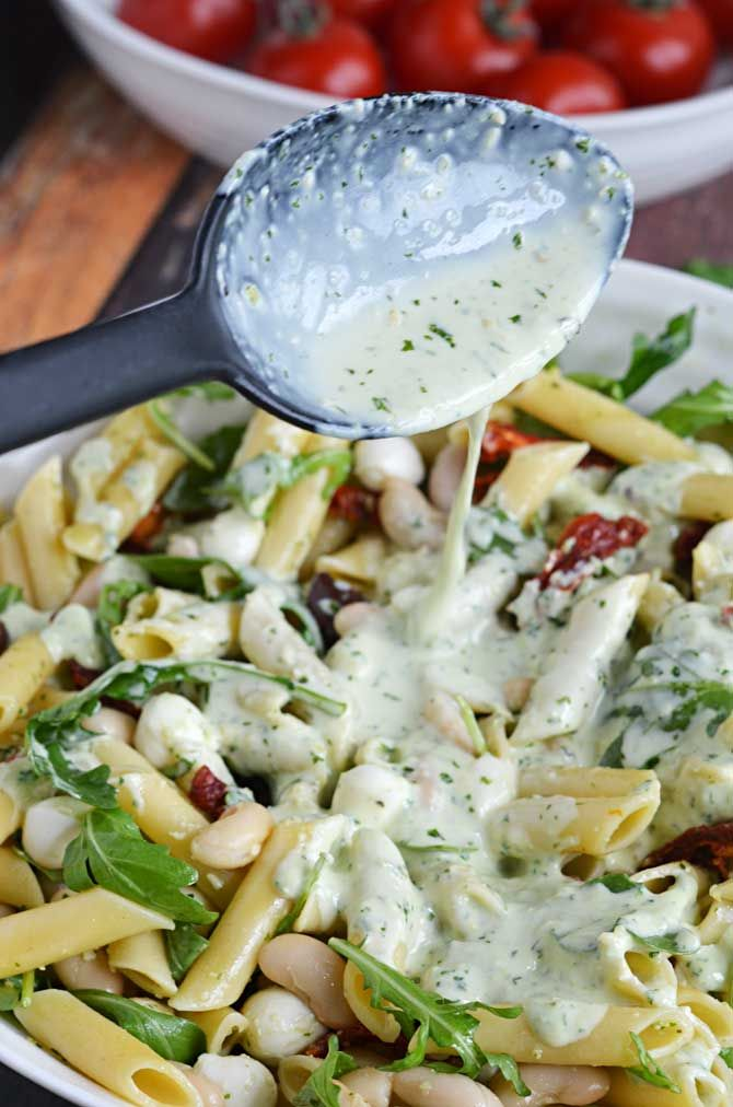 Creamy Pesto Pasta Salad! Perfect for your summer BBQs, picnics, and get-togethers!
