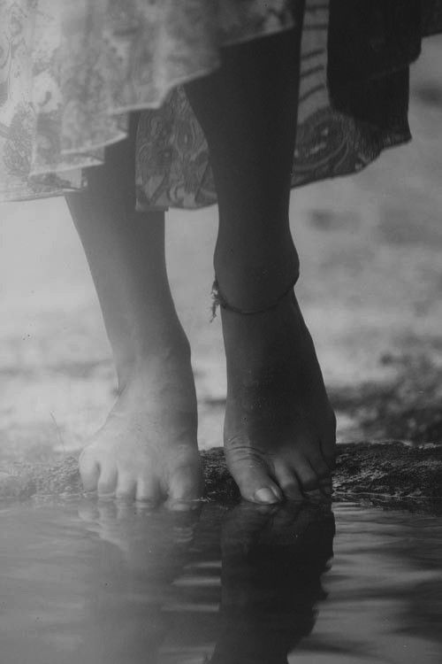 Walking barefoot ~ on the edges of each other's soul ~ footprints softly ~ smudging yours ~ blurring mine ~ until the lines can no longer be defined ~ the melting happened before we had time ~ to hold back the sweet seeping of the heated tides.