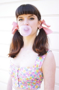 Erica blowing bubbles in the candy heart button down crop top
