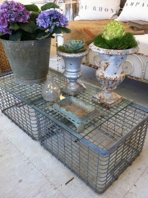 Cool metal coffee table idea - I had a coffee table like this in my very first apartment - I wrapped it in fabric though so no one would know it was crates - I've come full circle!