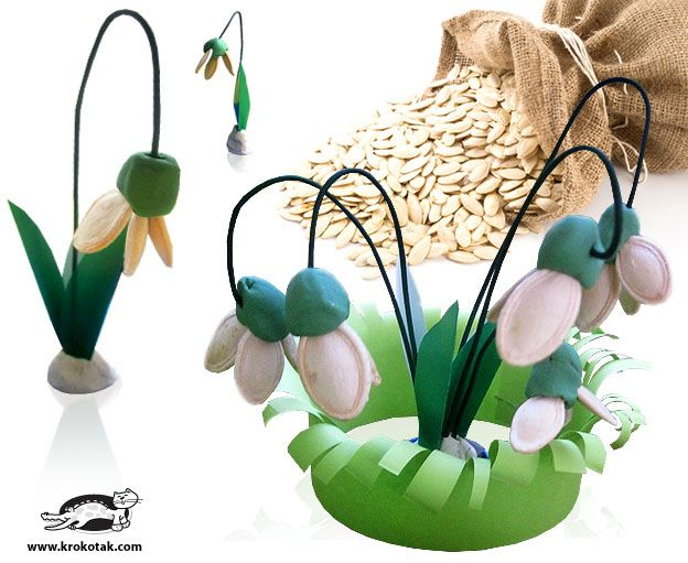 "so cute!! ""snow drop"" flowers (like the one in our garden!) out of clay, wire, and pumpkin seeds"