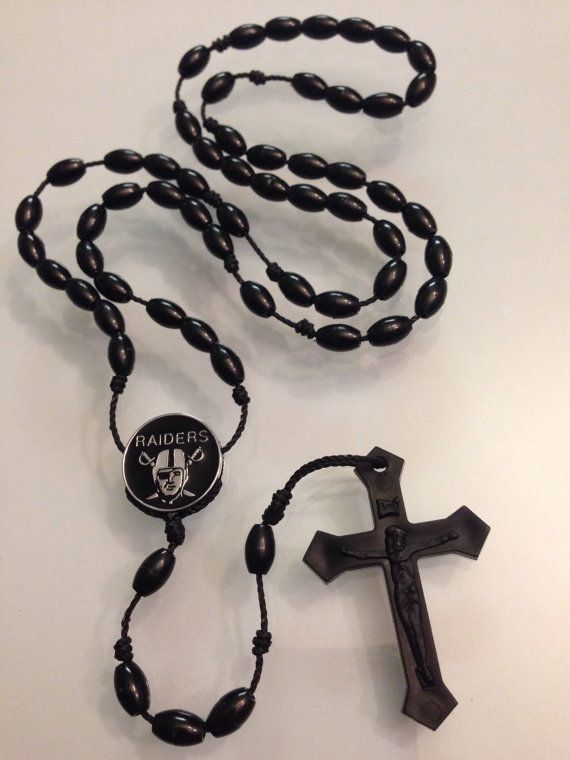 Handmade cord rosary with metal Raiders symbol and black plastic cross.