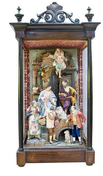 Nacimientos Napolitanos Misterios Napolitanos Nacimiento Napolitano dentro de una vitrina de madera y cristal, imitando antigua.