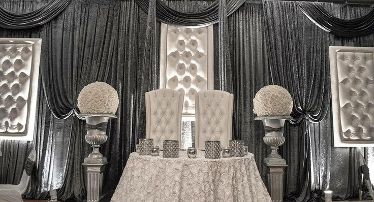 Beautiful silver decor by Elegance By Design Inc. & Chairs by Modish Lounge Rentals!
