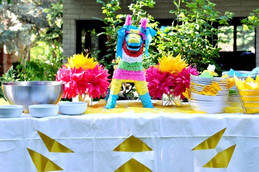 A piñata and paper decorations, very colourful!