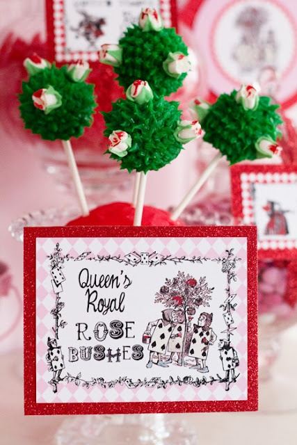 Alice in Wonderland or Queen of Hearts cake pops: white rose bushes painted red - cute idea!
