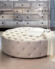 """""""Bevin"""" Tufted Ottoman Impressive button-tufted ottoman works equally well as a coffee table alternative. Imported.      Handcrafted of viscose/linen fabric and plywood.     47""""Dia. x 16""""T."""
