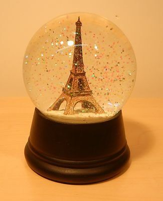 Love snowglobes!  The exact origin of the snow globe is unknown. But most experts believe the snow globe concept sprung from the paperweight. The first documented snow globe was an Eiffel Tower globe that appeared at the 1889 Paris Exhibition.