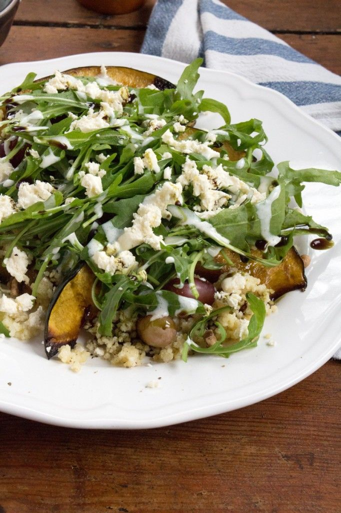 Baked Acorn Squash with Millet, Arugula & Grapes