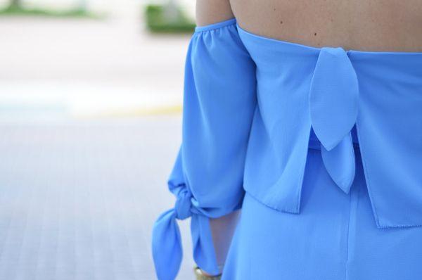 Back shot of the Saylor Alli dress with knot details.