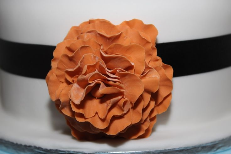 Burnt orange fondant flower