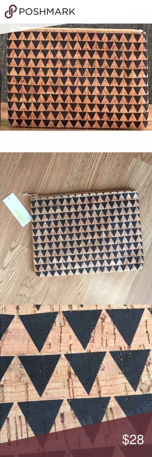 Triangle Cork Clutch This clutch has a slim construction that makes it easy to carry all day & night, has a fully lined interior with a small zip pocket, zip top closure, exterior is cork material. 11.25in(L) 8.5in(H) 1in(W)  *NO OFFERS ON BUNDLES Skull & Arrow Shop Bags Clutches & Wristlets