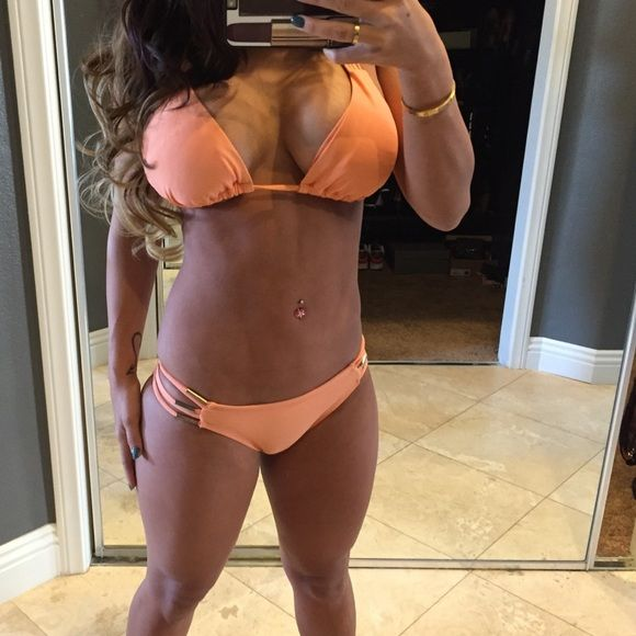 Coral bikini  Only worn a few times it is just like new! Large top small bottoms !! Clearing out all bikinis!! Not by brand listed used for exposure !! Last pic is the back side of bottoms Luli Fama Swim Bikinis