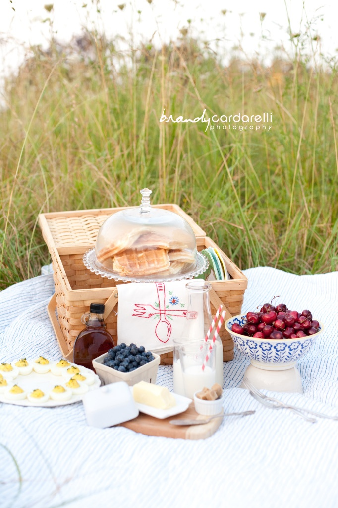 breakfast picnic of waffles, cherries and maple syrup