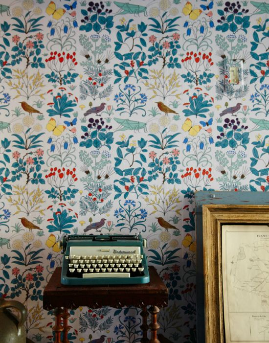 Super pretty wallpaper with birds and turquoise. Charles Voysey's Apothecary's Garden.