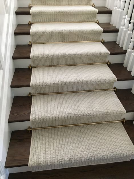 New Zealand wool broadloom carpet fabricated into a stair runner with serged edges.  Stair rods add a nice touch.  Purchase at Hemphill's Rugs & Carpets Costa Mesa, CA