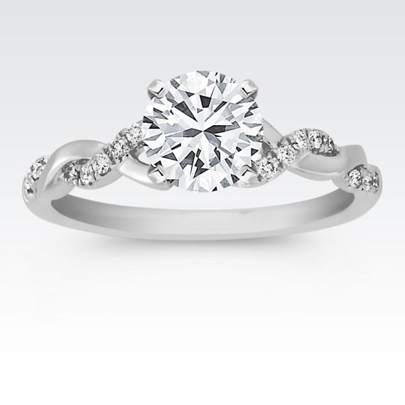 infinity diamond ring. a charming infinity design in 14 karat white gold gives this engagement ring unique look diamond e