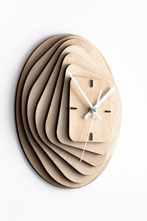 The clock consists of 11 laser cut 3mm birch plywood parts with 7 main layers with 3mm space between them and 4 construction parts that are also cleverly used as a main hour dial.The layers are forming transformation from outer circular shape to inner s… More