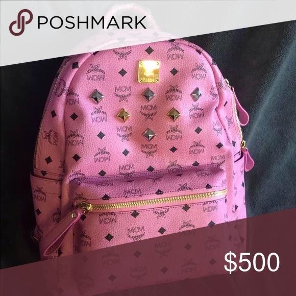 Pink MCM Backpack Pink MCM Backpack, in the large size. Used a couple of times but still in 99% perfect condition.... 100% authentic(cards included)! Interior has no stains and no smell. Will come with dust bag MCM Bags Backpacks