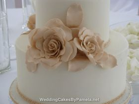 "An elegant Wedding Cake for a beautiful & intimate Wedding. Created with sharp edged royal icing & huge handmade sugar roses. The ""nude"" shades were so soft and pretty & the braided ribbon added the finishing touch. Pamela designs and makes Wedding Cakes for destination weddings in the French Riviera, Provence, Var and Alpes Maritime. Delivering throughout the region from Monaco, Nice, Cannes, to Saint Tropez & Aix en Provence and everywhere in between."