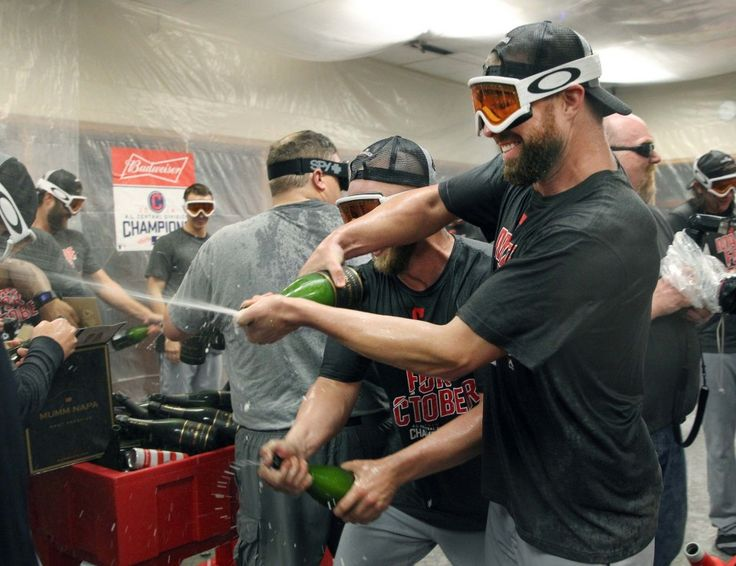 Cleveland Indians Cory Kluber and Cody Allen (behind) douse Indians CEO Paul Dolan with champaign in the Indians locker room after the Indians beat the Detroit Tigers  7-4 at Comerica Park in Detroit, Michigan on September 26, 2016.  (Chuck Crow/The Plain Dealer)