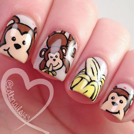 These monkey nail art complements all of your monkey business.