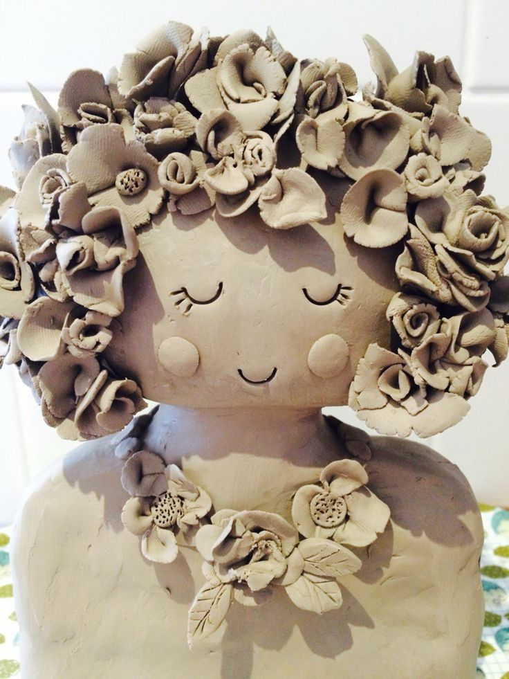 Claire Paveley ceramic flower head girl